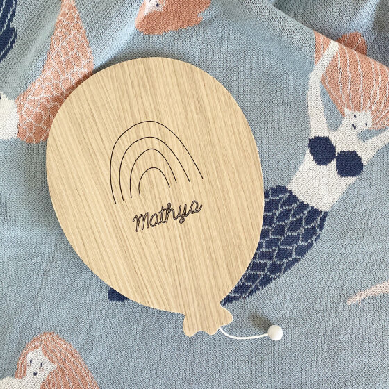 Un design en bois sobre et personnalisable avec son nom